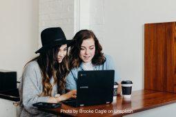 Image of two women using laptop